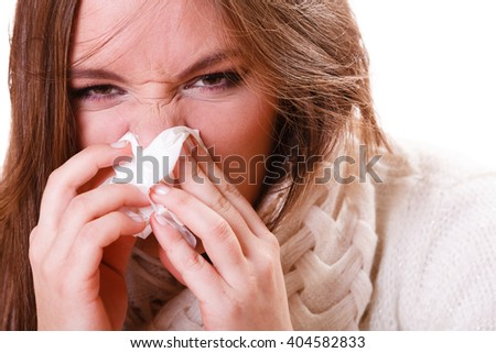 Flu cold or other virus. Sick woman girl with fever sneezing in tissue, suffering from quinsy. Health care. - stock photo