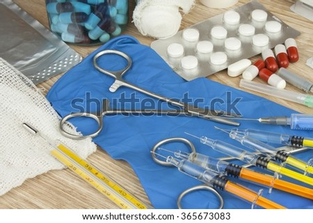 Flu epidemic. Vaccination against influenza epidemic. Syringe and Sterile Vial Filled with Medication Solution. An Injection Pharmaceutical Dosage Form. - stock photo