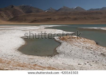 Fluctuating salt lake Tso Kar situated in the Rupshu Plateau, Ladakh, India - stock photo