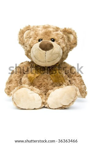 Fluffy brown teddy bear sitting down - portrait interior - stock photo