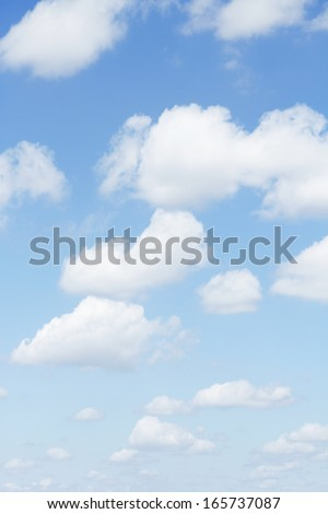 Fluffy clouds in a blue sky - stock photo