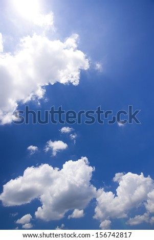 Fluffy clouds in blue sky - stock photo