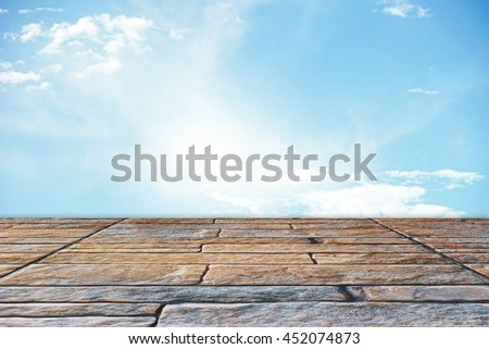 fluffy clouds in the blue sky and grunge floor - stock photo
