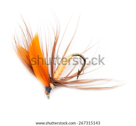 Fluffy fly fishing hook isolated on white - stock photo