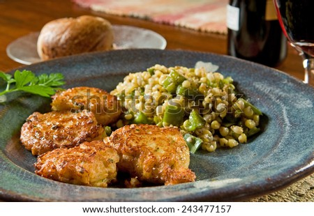 Fluffy homemade codfish fritters - fried fish cakes served with corn and peppers - stock photo