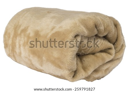 Fluffy warm, brown blanket rolled on a white isolated studio background - stock photo