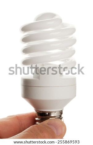 fluorescent lamp in hand isolated on white background - stock photo
