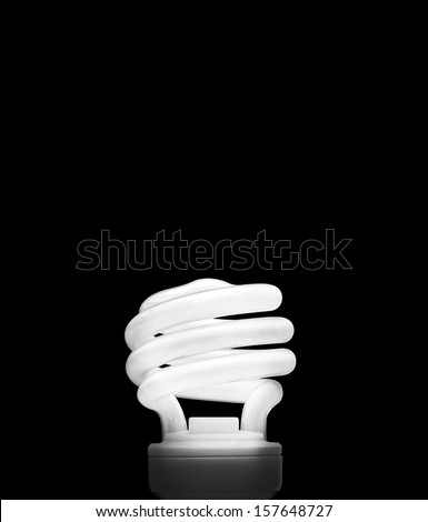 Fluorescent Light Bulb on a black background  (with clipping work path) - stock photo