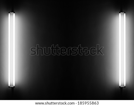 Fluorescent light tubes on the wall - stock photo