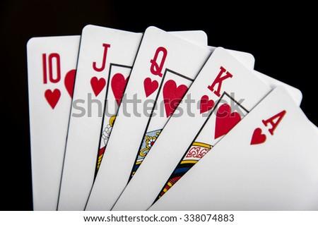 Flush royal cards isolated on black background - stock photo
