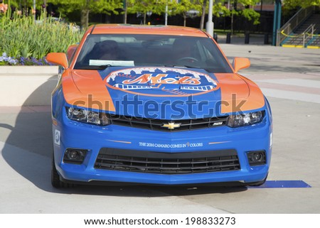 FLUSHING, NY - MAY 18  Chevrolet Camaro Mets Special Edition car in the front of the Citi Field, home of major league baseball team the New York Mets on May 18, 2014   - stock photo