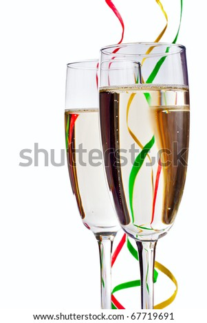 Flute Champagne glasses with paper streamers isolated on white - stock photo
