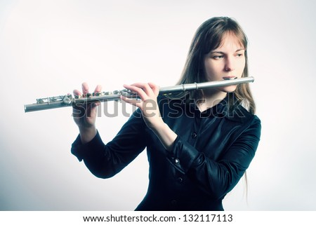 Flute music instrument flutist musician playing. Classical orchestra instruments - stock photo