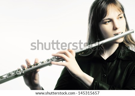 Flute music instrument flutist player. Classical orchestra instruments playing - stock photo