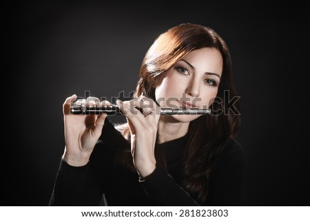 Flute piccolo flutist woman playing flute music instrument - stock photo
