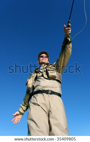 Fly-fisher seen from below - stock photo