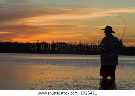 Fly fishing in the morning sun 16 - stock photo