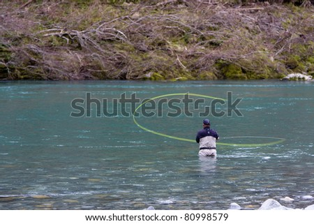 Fly fishing on the Smith River in Northern California - stock photo