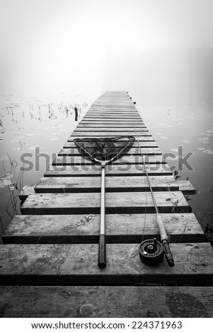 Fly fishing set on the bridge in monochrome - stock photo
