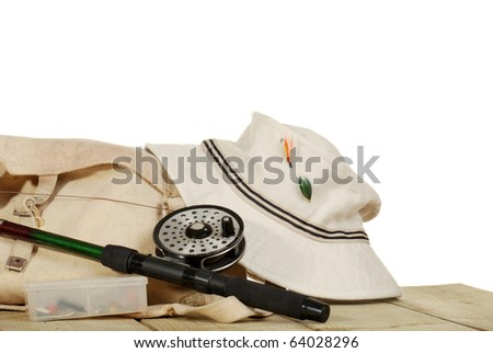 fly fishing tackle on a dock isolated - stock photo