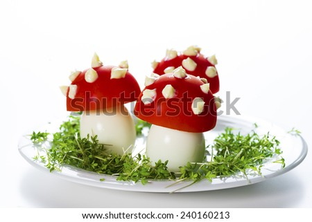 fly mushrooms made from boiled egg ,tomato and mayonnaise - stock photo
