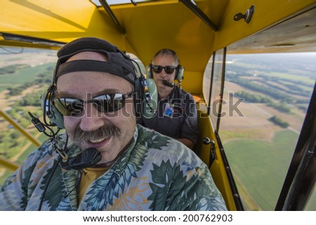 Flying a vintage aircraft - stock photo