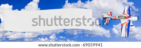 Flying airplane and banner - sky on background - stock photo
