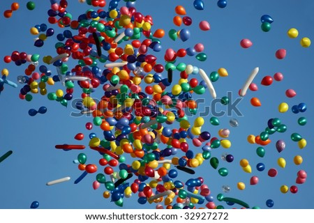 Flying balloon after celebration in the clear blue sky - stock photo