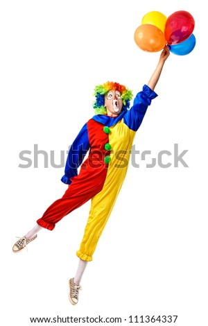 Flying birthday clown with a bunch of balloons. Full body isolated - stock photo