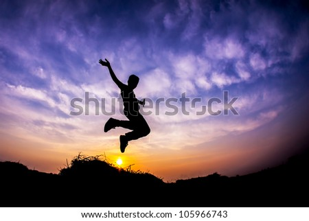 Flying boy during sunset in Silhouette - stock photo