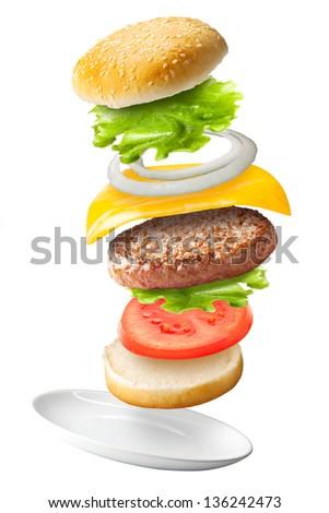 Flying classic hamburger on isolated background /Big hamburger with fresh ingredients. - stock photo