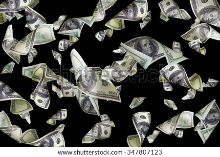 Flying dollars isolated on black background - stock photo