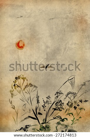 Flying dragonfly and a butterfly net in the grass - stock photo
