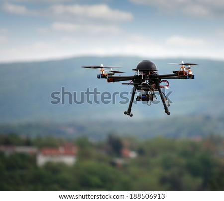 flying drone with camera on the sky  - stock photo