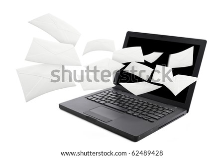 Flying email from computer - stock photo