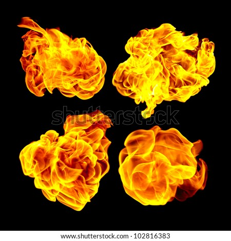 Flying fire balls. Fire balls isolated on black background. - stock photo