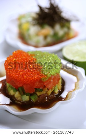 Flying fish caviar appetizer / Yin-Yang Salad with Seafood and Avocado - stock photo