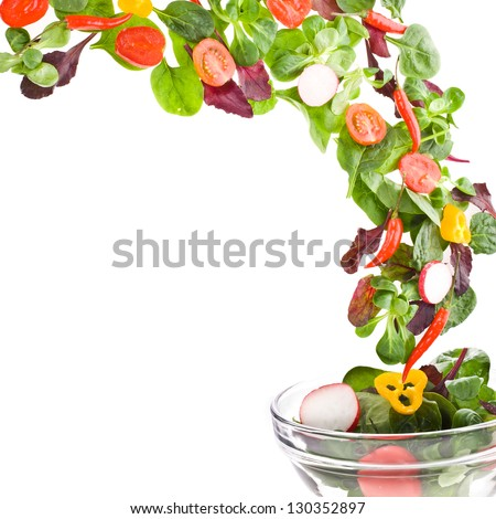 Flying  fresh salad isolated over white background - stock photo