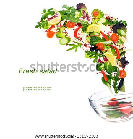Flying fresh salad isolated over white background - stock photo