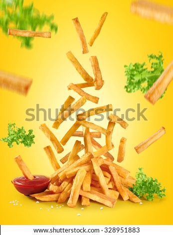 Flying fried potatoes, lettuce and ketchup. French fries.  - stock photo