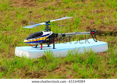Flying helicopter (radio controlled scale-model 1:24 scale) Teleobjective shot with shallow DOF. - stock photo