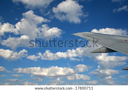 flying in the clouds - stock photo