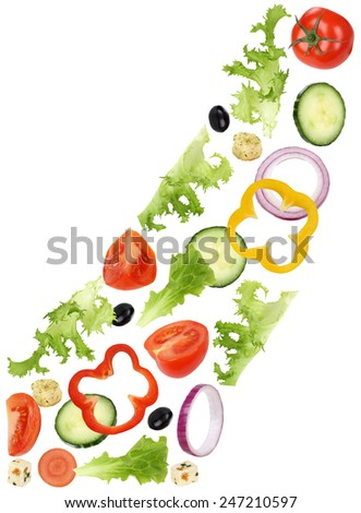 Flying ingredients for green salad with tomatoes, Feta cheese, onion, olives and cucumber - stock photo