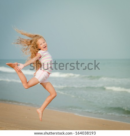 flying jumping beach girl at blue sea shore in summer vacation in the day time - stock photo