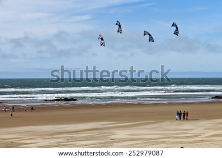 Flying kites on the beach Oregon Coast. - stock photo