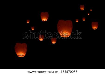 Flying lantern in the dark sky - stock photo