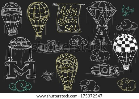 flying objects set with hot air balloons, parachute, airships, clouds, birds, letters A and M, charcoal in black background  - stock photo