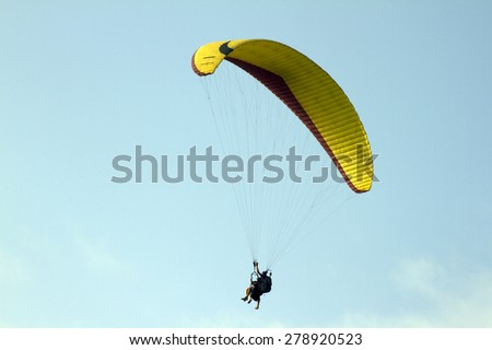 Flying on a parachute India Goa. - stock photo