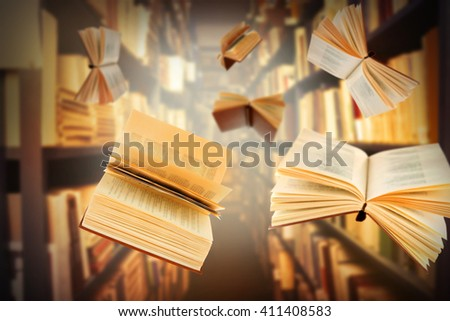 Flying open books in library - stock photo