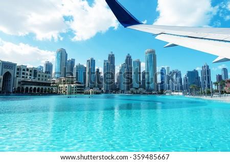 Flying over Dubai, United Arab Emirates. - stock photo